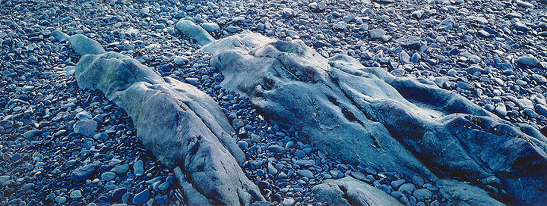 "Christopher Burkett ""Campobello Stone Figures,"" New Brunswick    Cibachrome Photograph    Available in 13"" x 33"", 20"" x 50"", and 25"" x 64"""