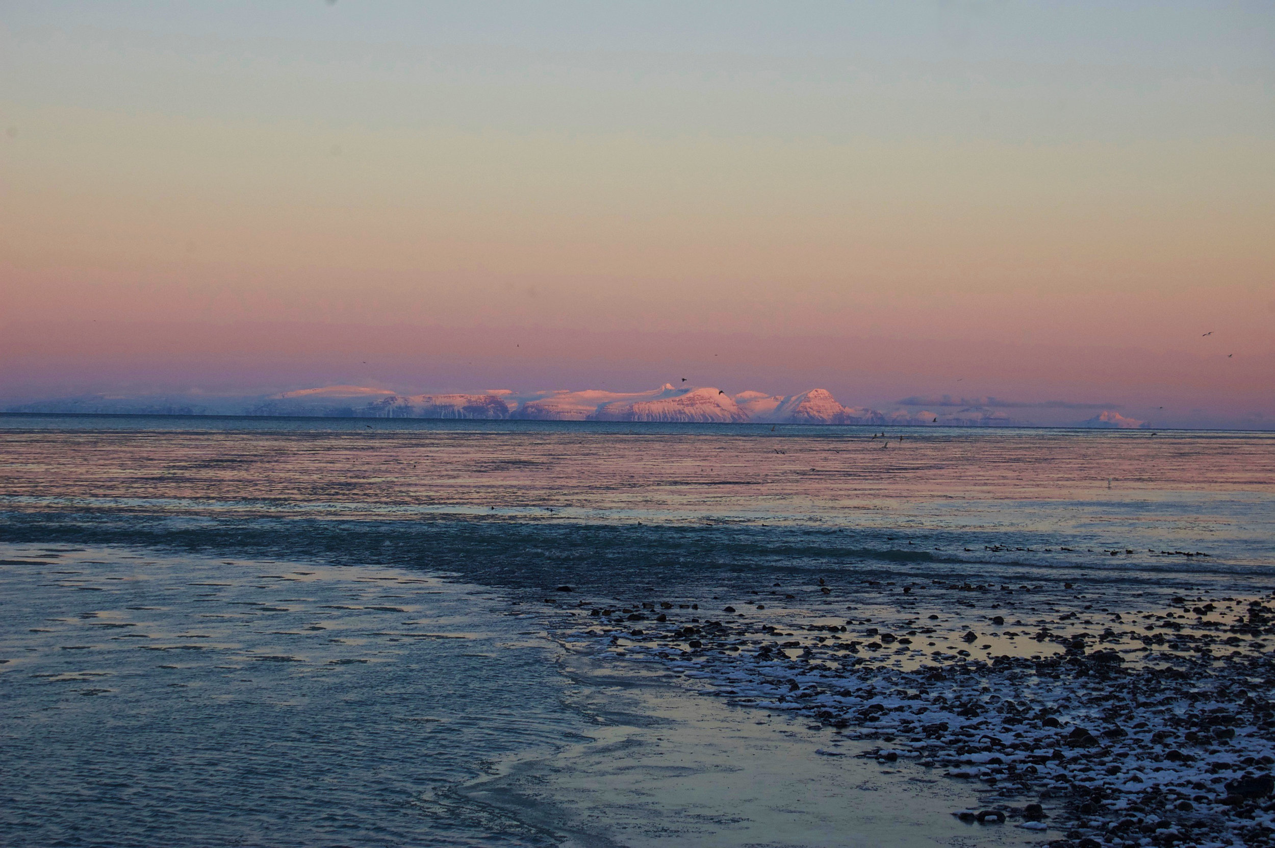 Sun reflecting off the glaciers as it rises -Blönduós, Iceland.