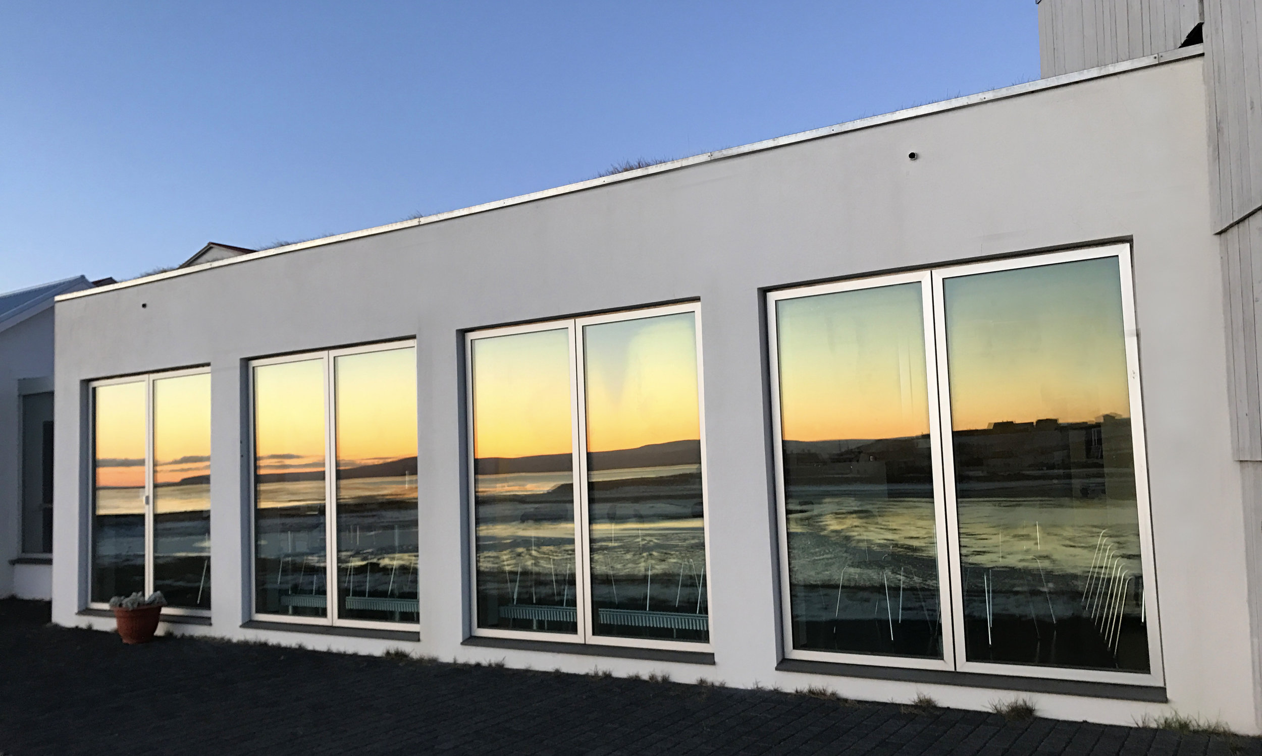 Sun reflecting off the windows at the Textile Museum at sunset -Blönduós, Iceland.