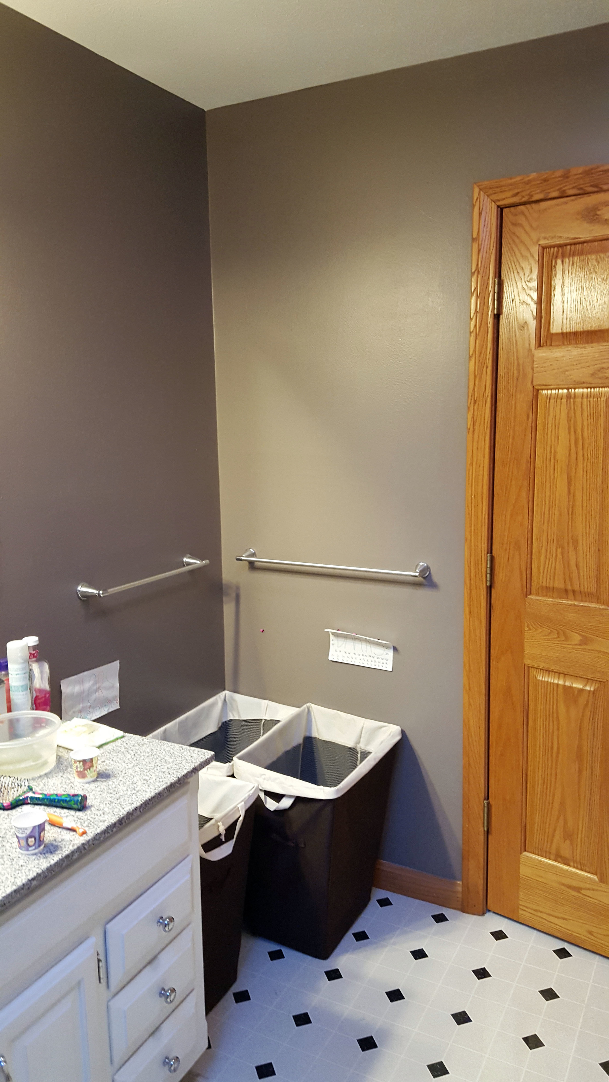 Before - underused space behind bathroom door