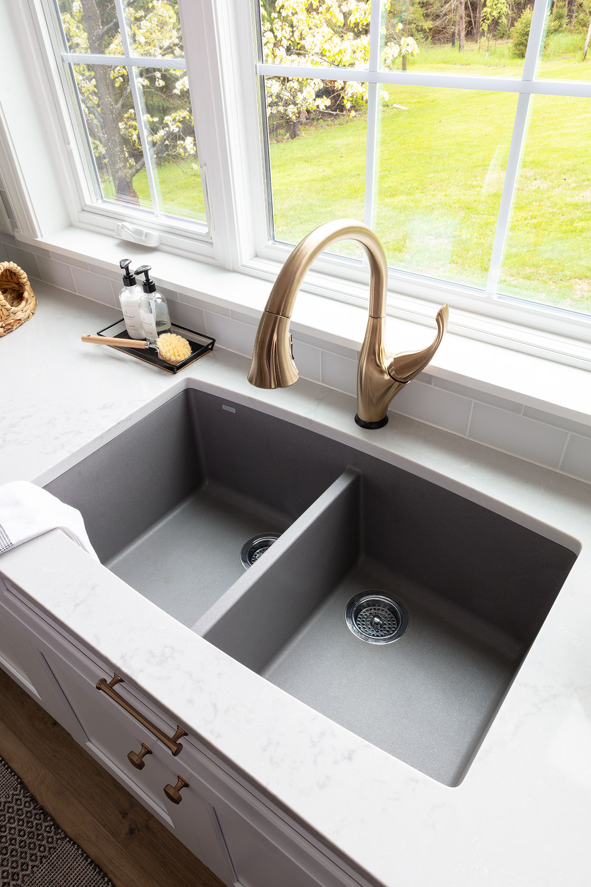white kitchen with blue island sink and faucet
