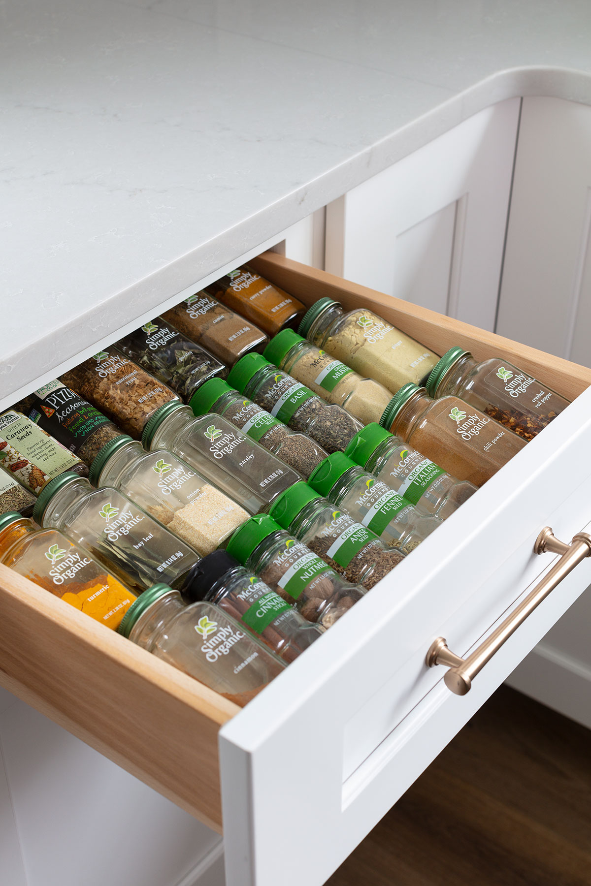 white kitchen with blue island spice drawer organizer