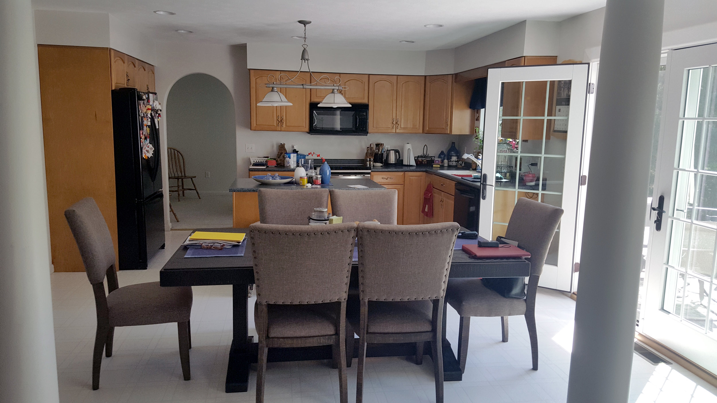 BEFORE: An eat-in kitchen was tucked in the corner with a dining room behind