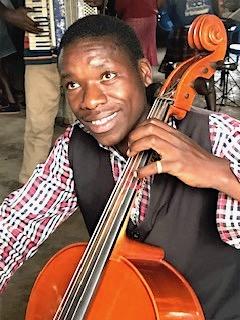 A proud cellist having so much fun making music!