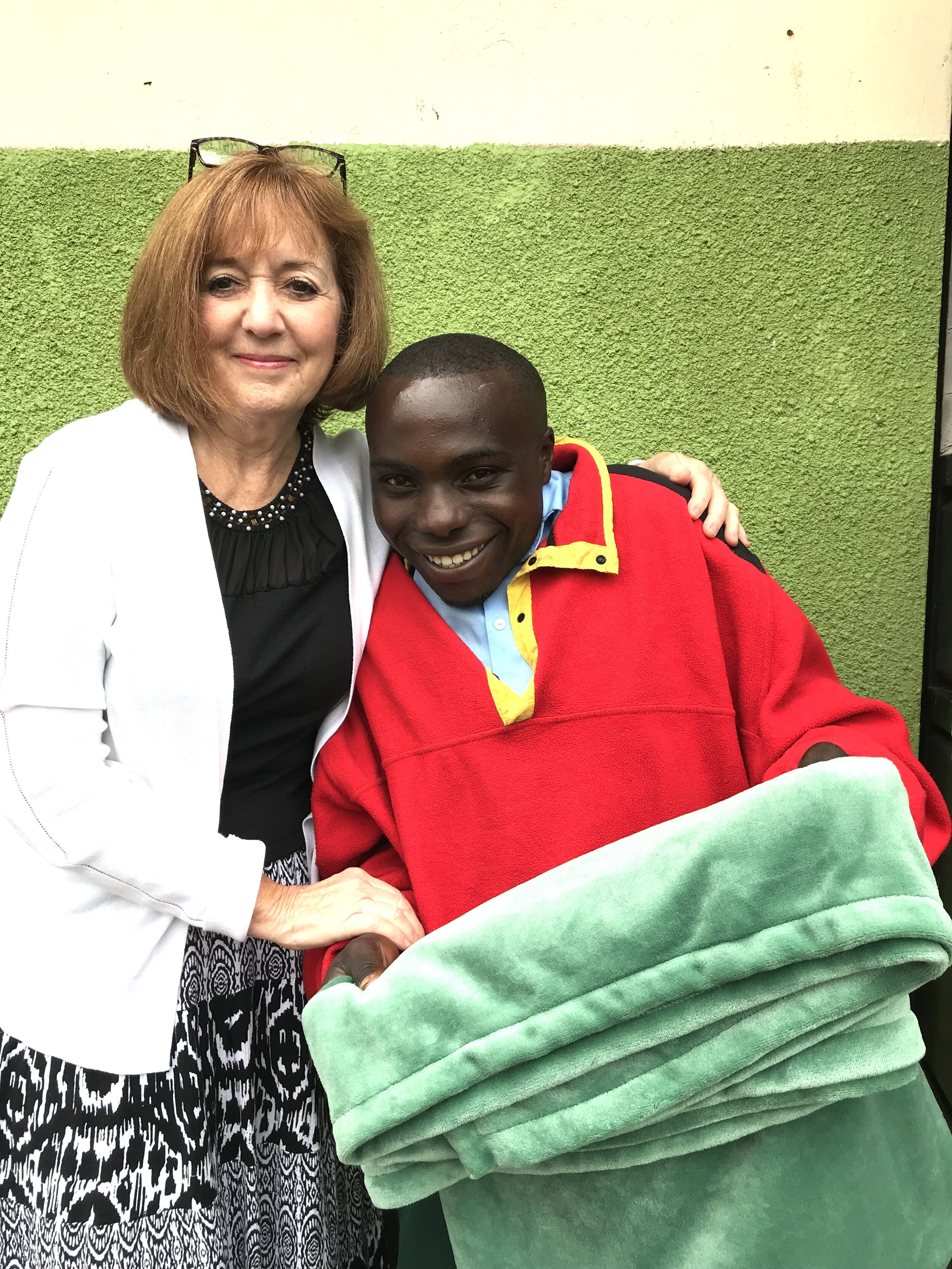 Osbert receives his gift from The Children's Therapy Corner! Osbert is in vocational school to become a cobbler.