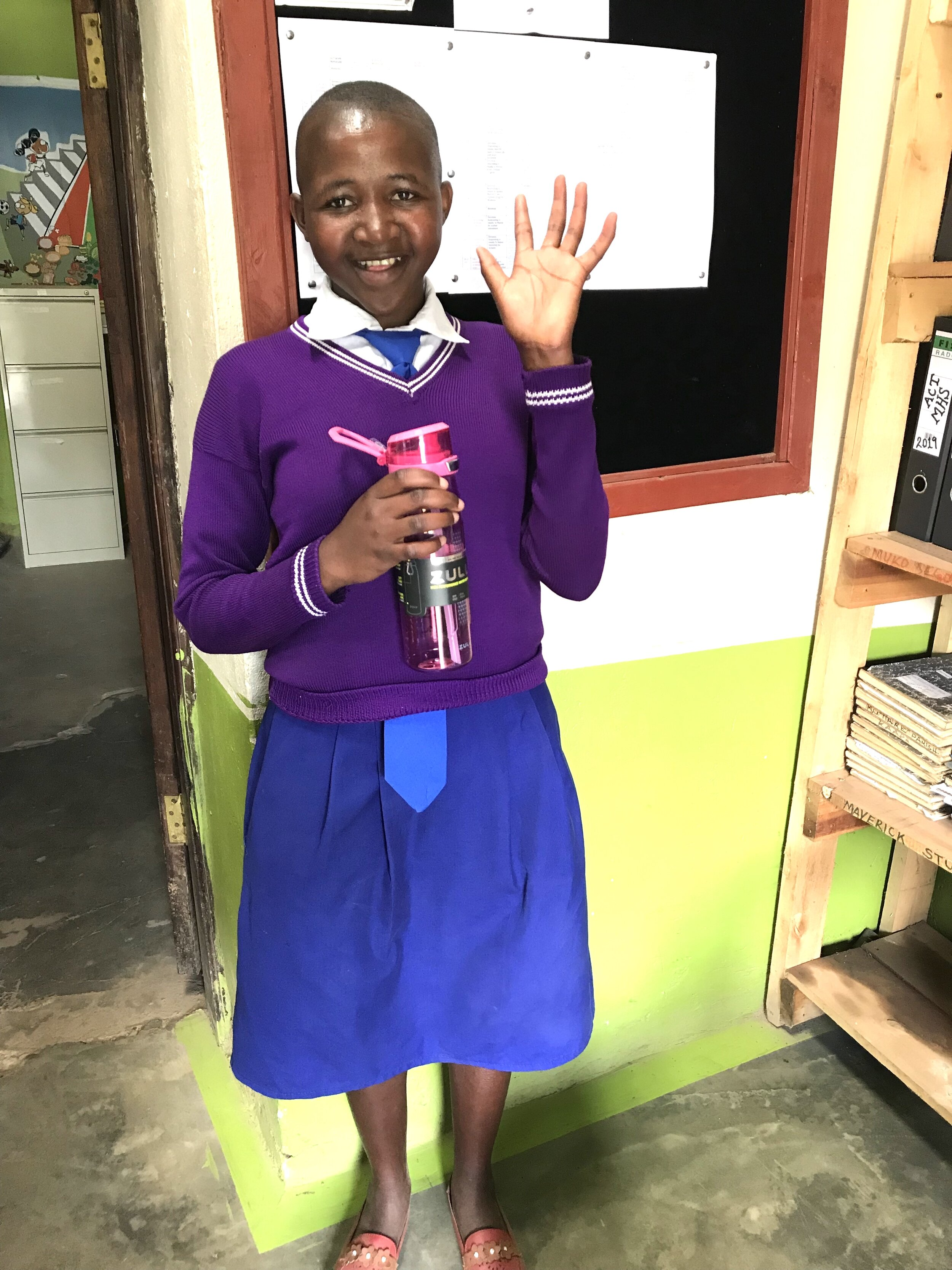 Precious prepares for classes at Muko High School.