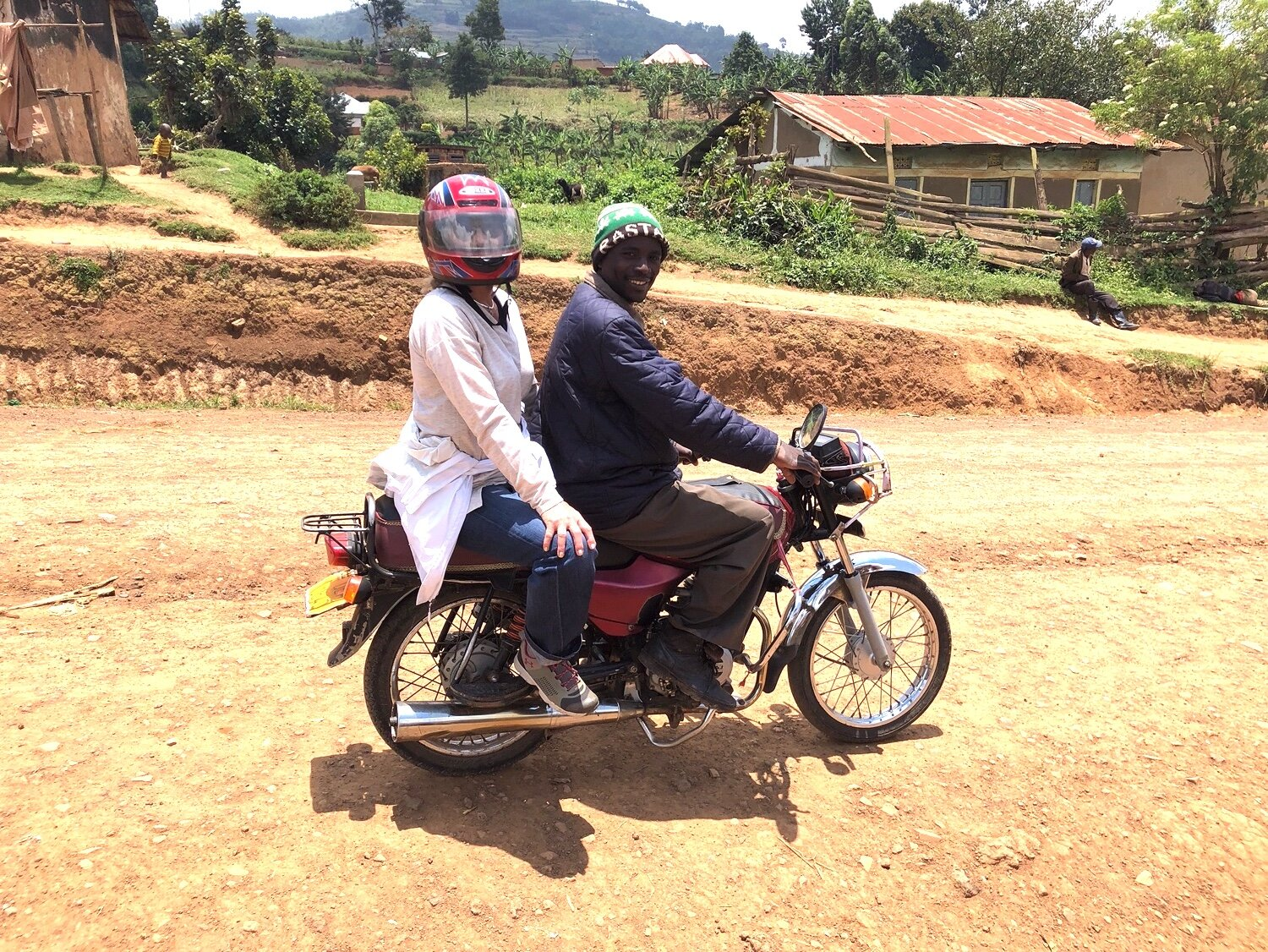 Sharalyn on a boda boda to go to the gardens for HANDS and to a dialogue for HEAL Programs