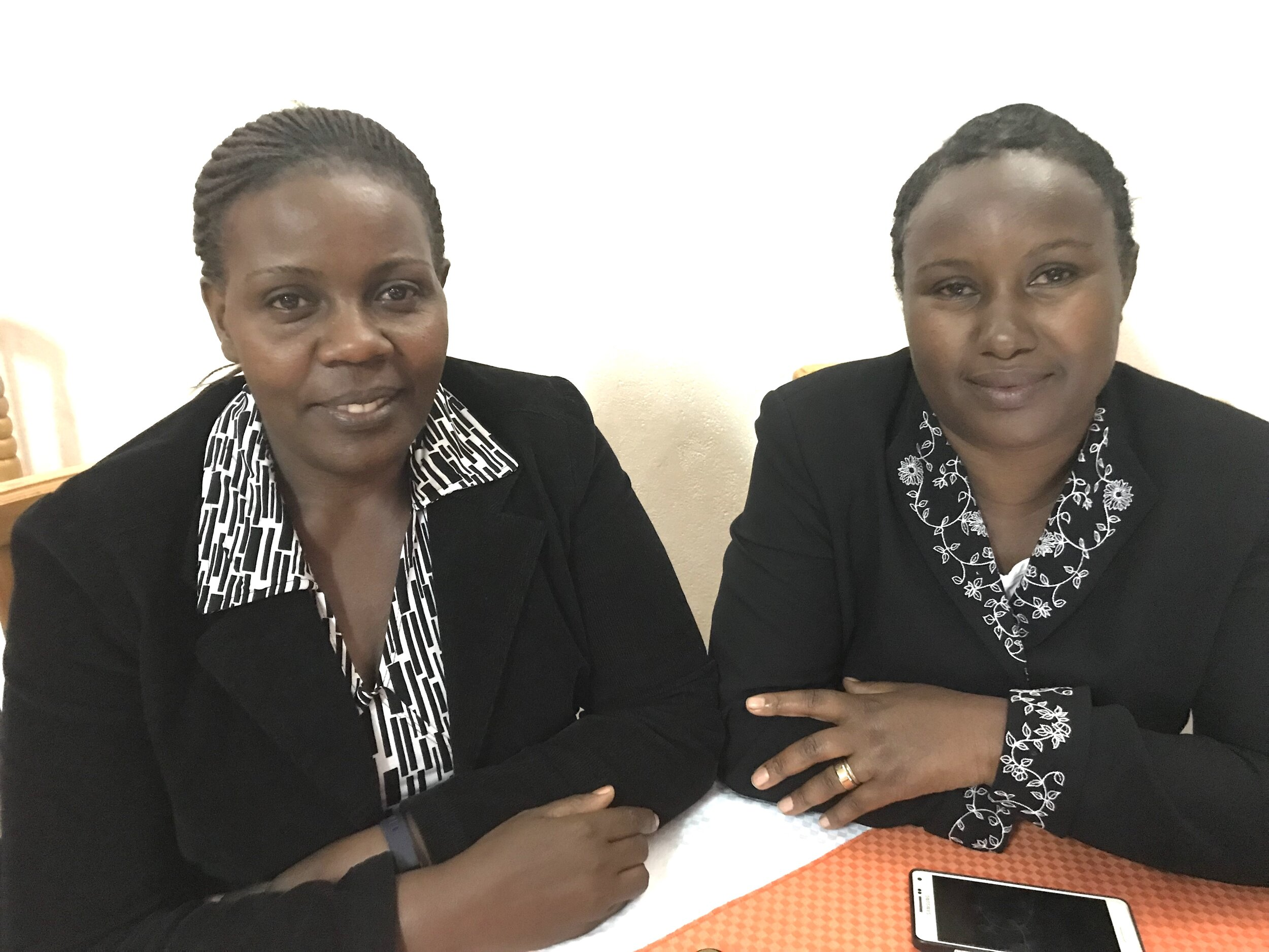 2 Beautiful Professional Ugandan Women: Lydia Komugisha and Generous Turinawe. Lydia is a Hospital Administrator and the past Chair of the ACT Uganda board. Of course, Generous is our highly competent Director of ACT!