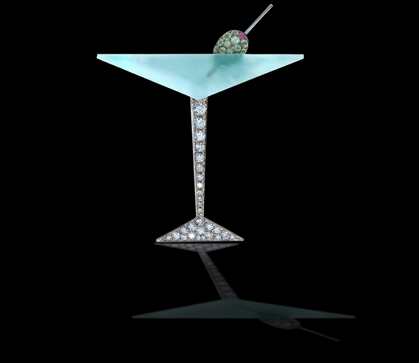 Bombay Sapphire   You wear a brooch of your favorite drink. Everything you do is about your favorite things. You are proud to show off your unique personality    18 Karat White Gold, Aquamarine, White Diamonds, Peridot, and Pink Sapphire $9,800