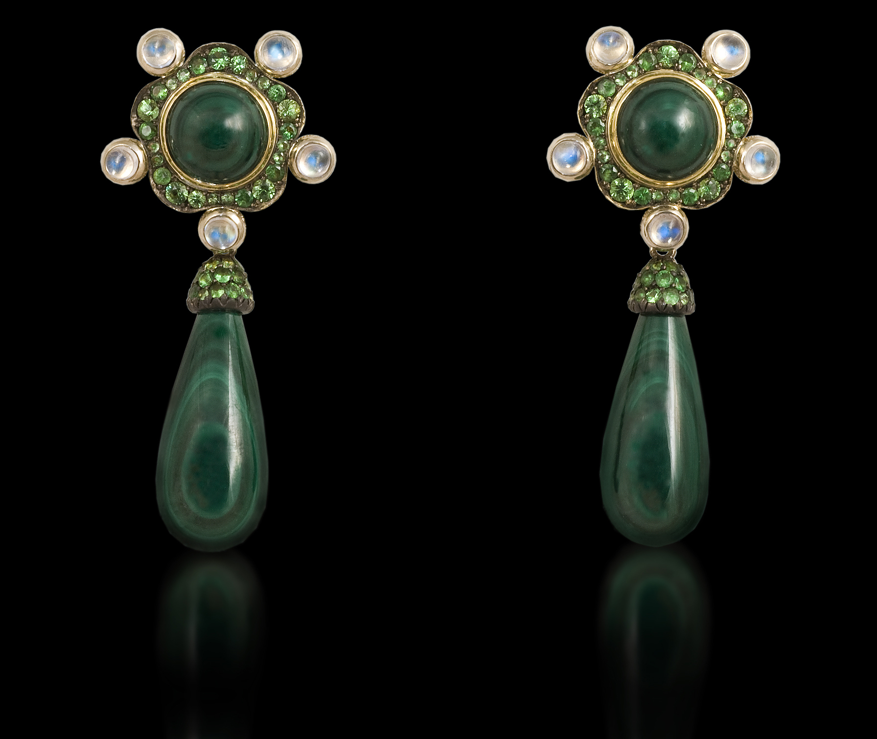 Ethiopian Queen   In the darkness of the green forest jewels of water and gems sparkle in the night.    Earrings in 18 karat White Gold, with Malachite, Moonstone, and Green Garnet      $4.500