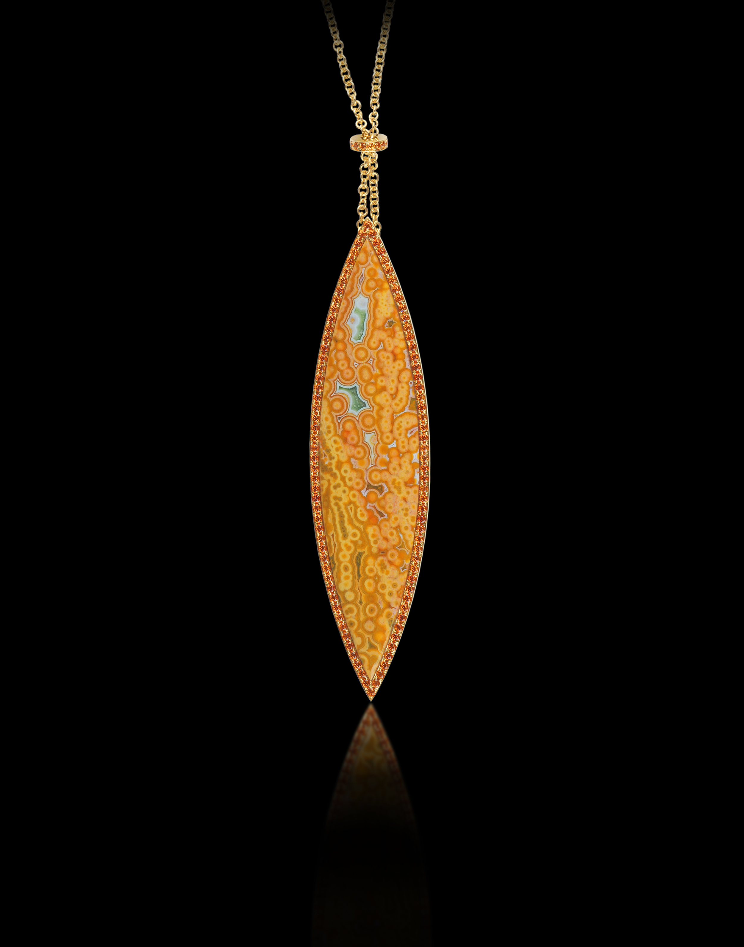 Pendulum   Elegance resides naturally in all of nature's wonders.    Brooch and Pendant in 18 karat Yellow Gold, and Spessartite Garnets      $4,000
