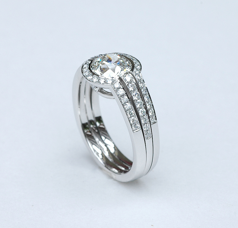 Platinum engagement ring with 1.7 ct center stone diamond and bright cut pave' set diamonds on the shoulders