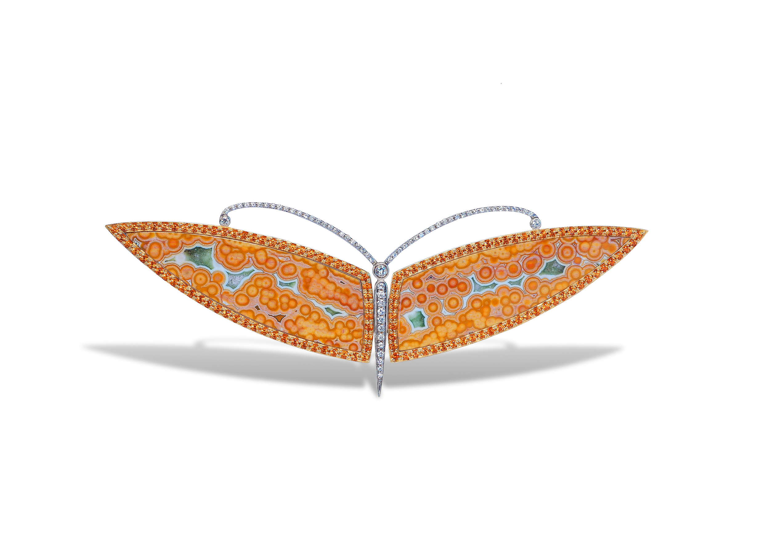brooch in 18 karat white gold, ocean jasper wings, and white diamonds in the antenna and body