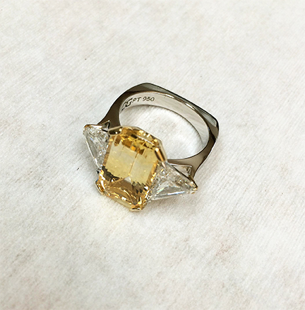 DGG yellow Sapphire ring with 18 yellow claws and with trilliant cut Diamonds set into 950 platinum