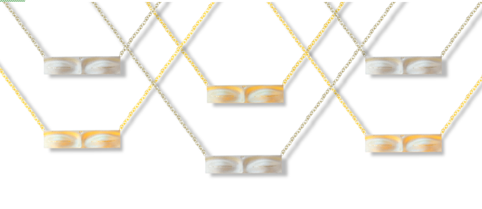 Delicate pendants in yellow gold and sterling silver