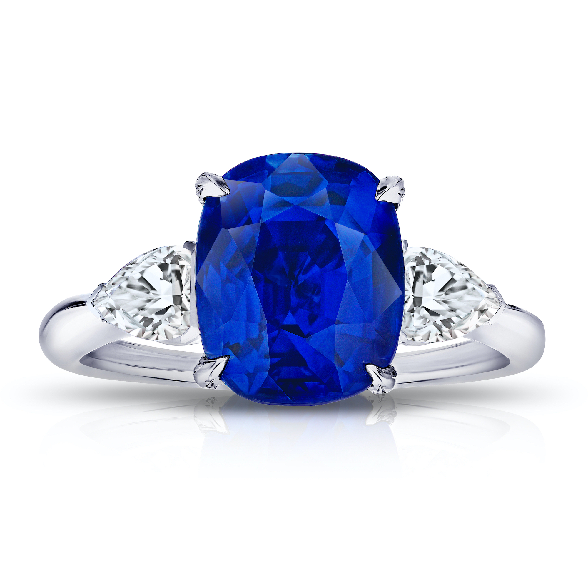 Exquisite blue sapphire and platinum ring with pear shaped diamonds on the shoulders.