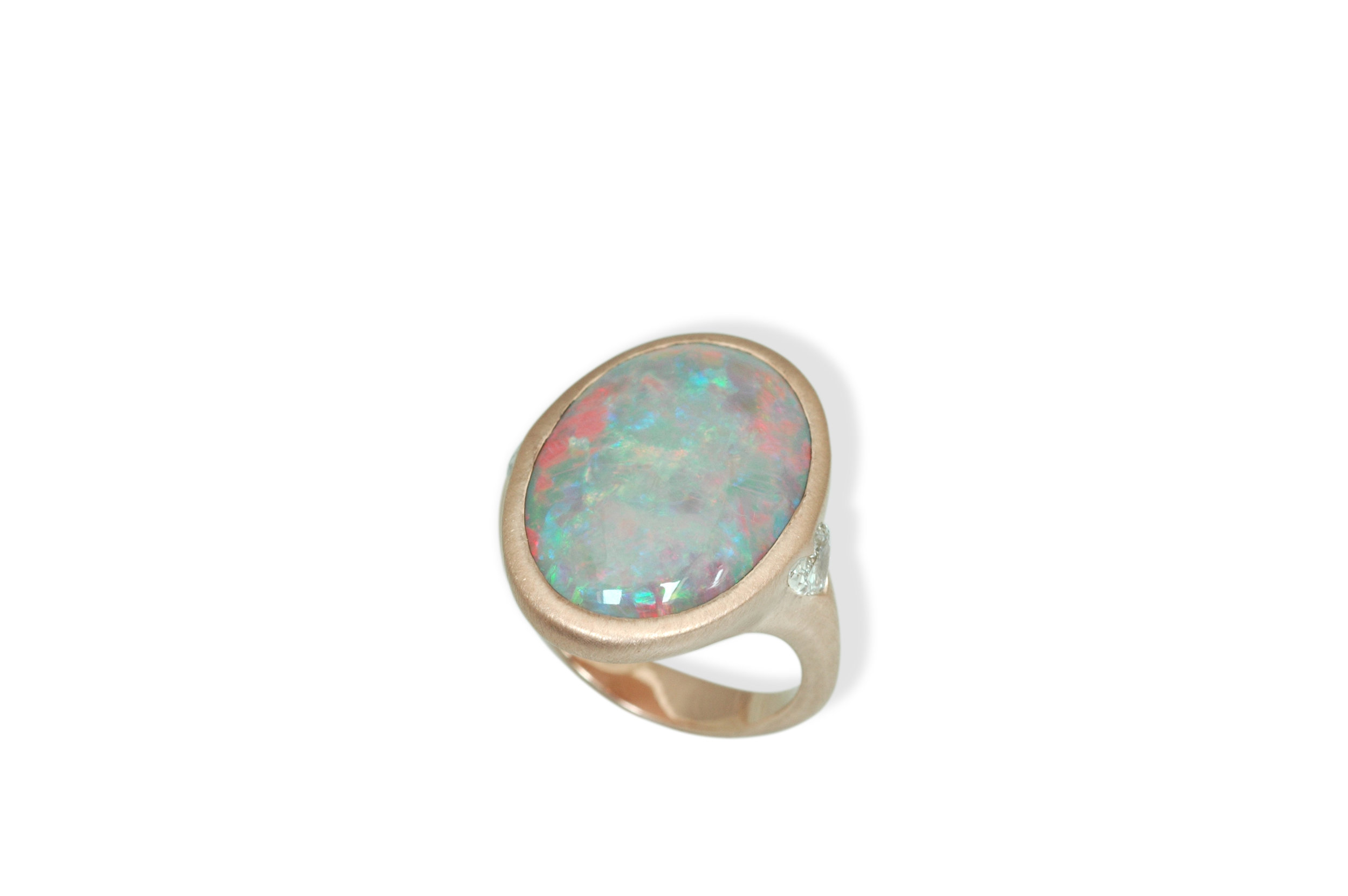 Rose gold ring with Australian opal and heart shaped diamond accents