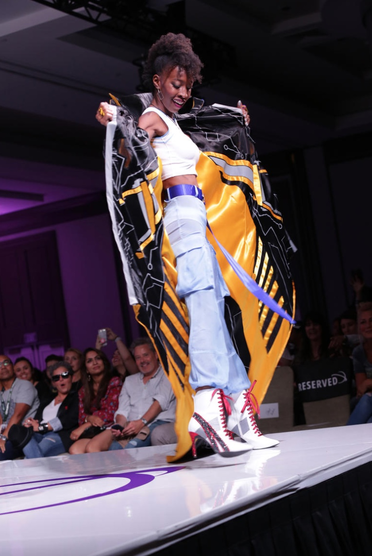 Mackenzi Bell-Nugent, a two time cancer survivor, totally slayed the runway with her walk! Photo by Jay Julio from TV Guide.