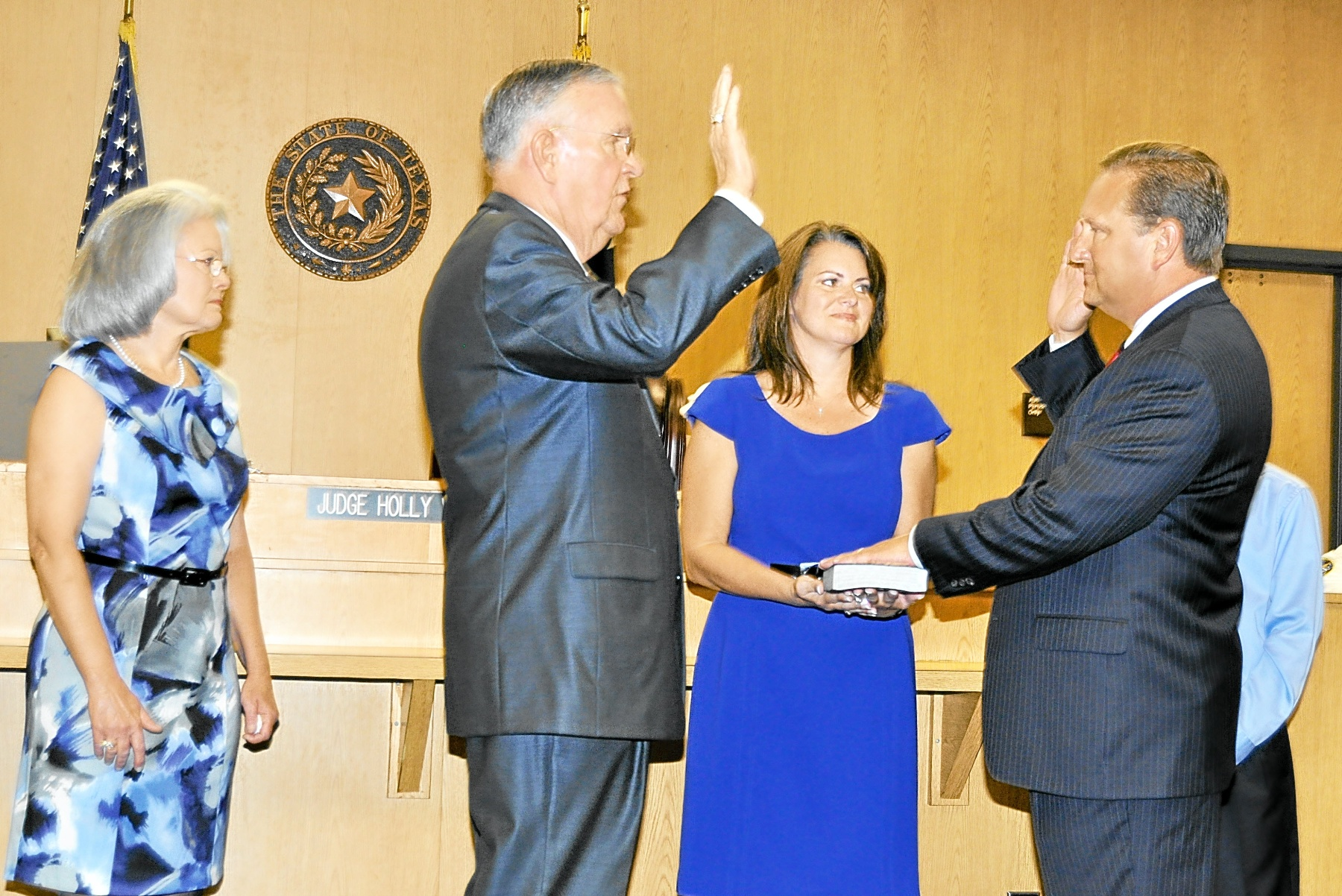Constable Sandlin, Joined by his wife nerissa and their son blake, is sworn in to office in 2011 by former constable Bill bailey.