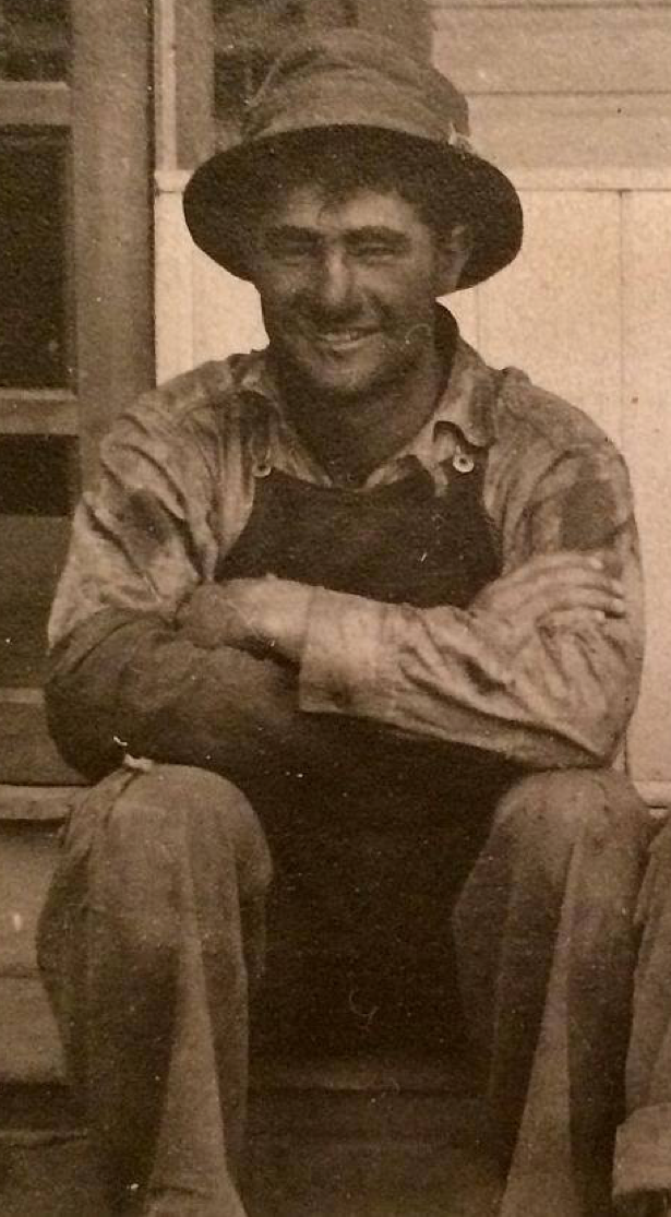Richard and Don's grandfather, Karl Scheuerman, during harvest