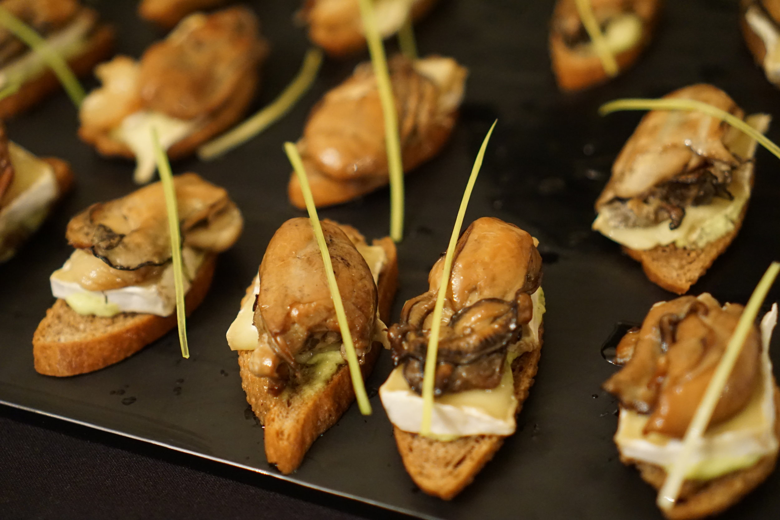 Smoked oyster and brie crostini made with  Sonoran Gold Wheat (Chris Lozier photo)