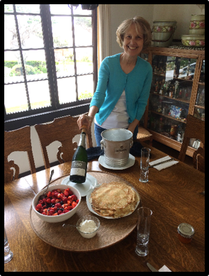 "Cousin Patty Poffenroth Bell tending our German ""Suesspleena"" pancakes  (Monterey Bay beyond the windows!)"
