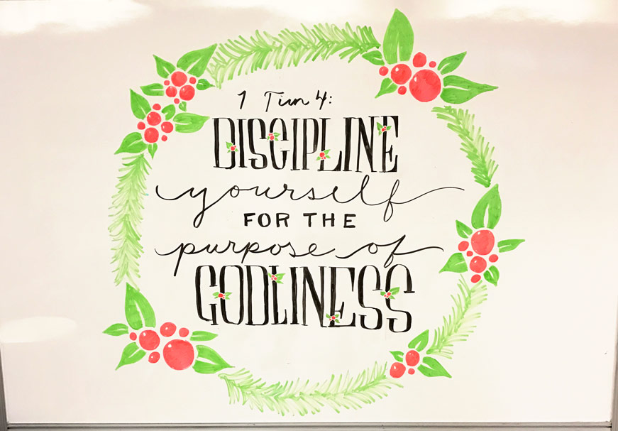 Discipline yourself for the purpose of godliness.//This hand-lettered Scripture calligraphy whiteboard design was made by Sarah Mikucki of Doorpost Designs for a women's ministry event at Grace Christian Fellowship Church in Spokane, WA.