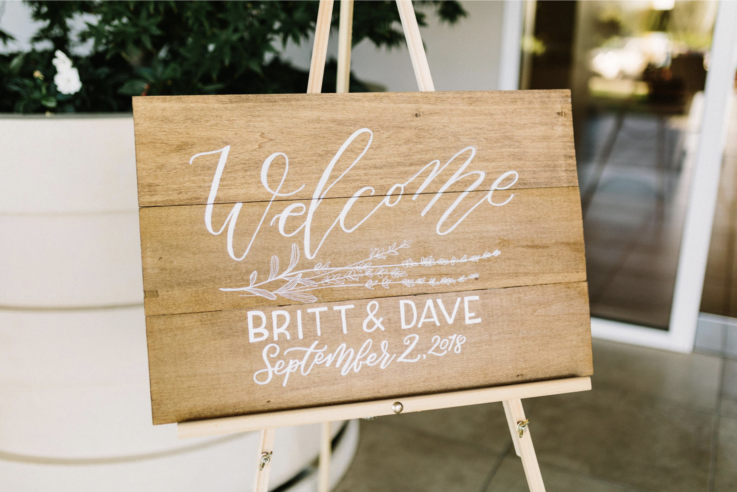 Wedding welcome sign, hand-lettered/hand-painted in calligraphy.