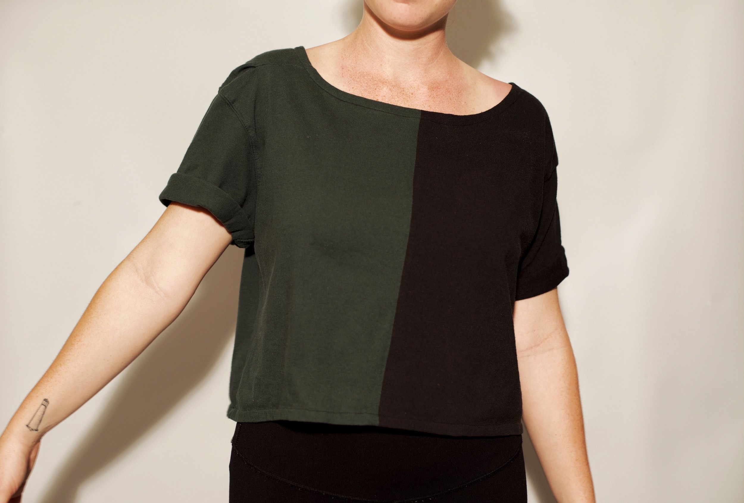 Vintage t-shirts combined to make one cropped shirt