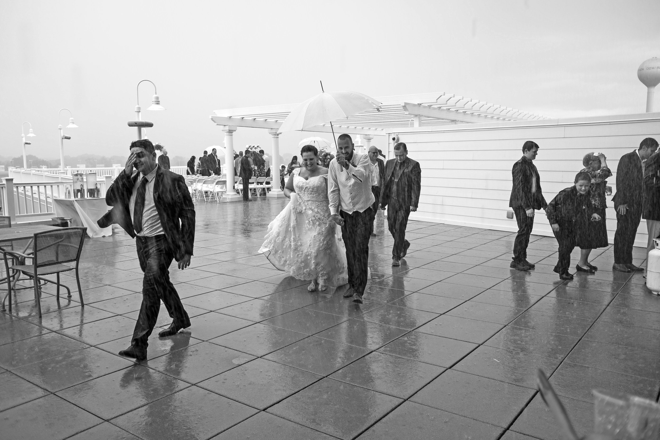 Caitlin and Freddy get married in the rain at Vernon Downs Casino on September 2, 2018 in New York
