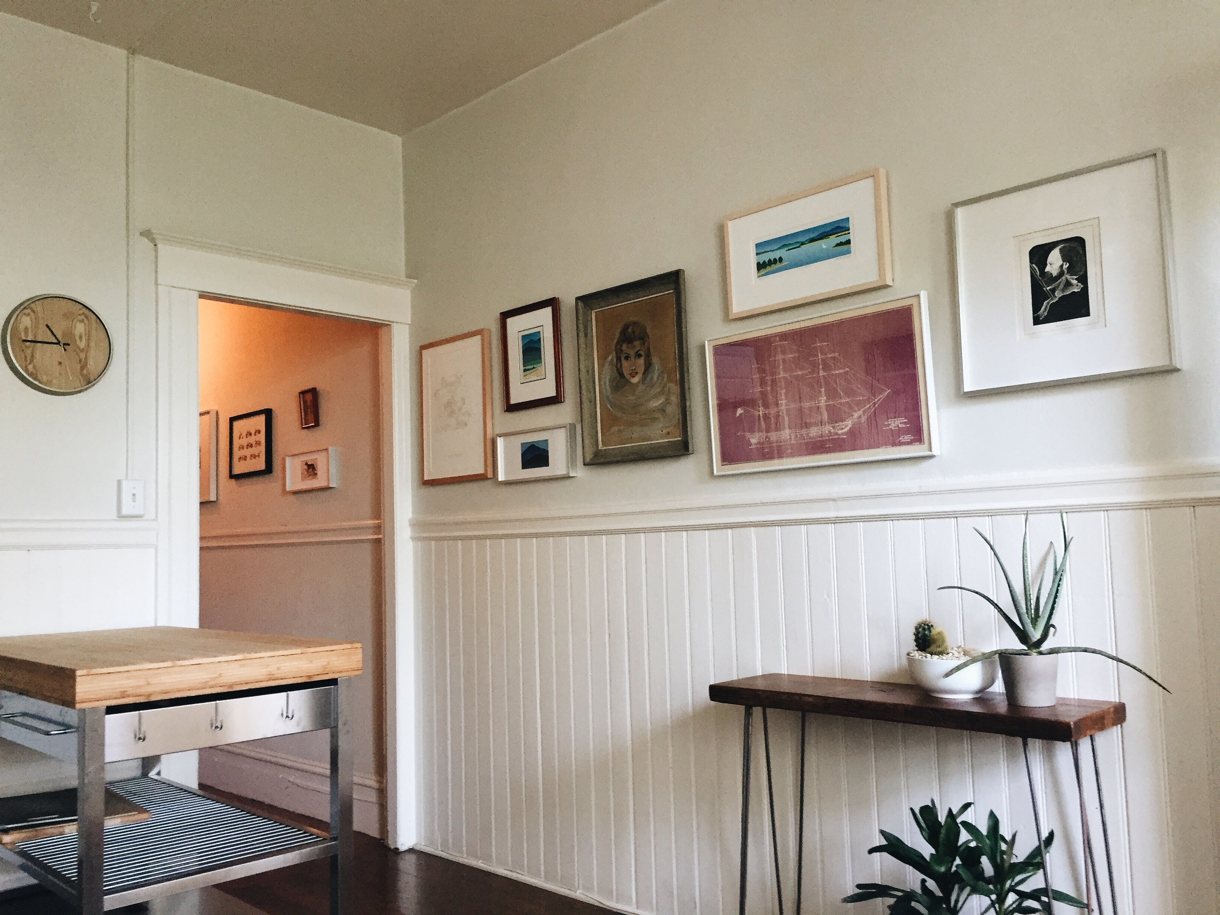 Then you can walk down a long hallway to the kitchen. We hung up a lot of art and basically made a really long gallery wall leading into the kitchen area. We are pretty happy with it.