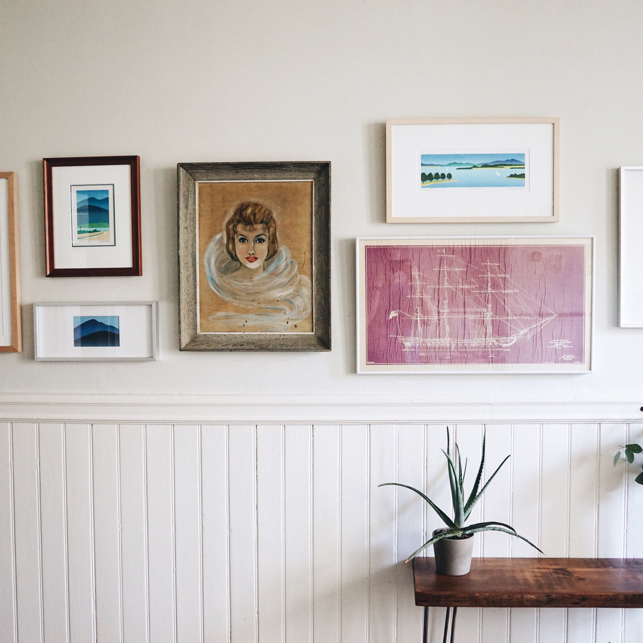 A close up of the gallery wall. Jean is the woman in the center. She is our house mother.