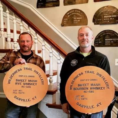 Wilderness Trail Master Distiller and Co-Owner, right, holds a copper stencil to be used on the distillery's barrel heads for bourbon and rye. Look for Wilderness Trail's first whiskeys this December.