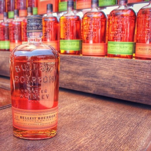 Bulleit Bourbon, with the orange label, is a popular Bourbon whiskey that is both sweet and spicy. The spicier Bulleit Rye, with the green label, is the top-sellilng rye whiskey in the world. (Photo credit: Bulleit Frontier Whiskey Experience)