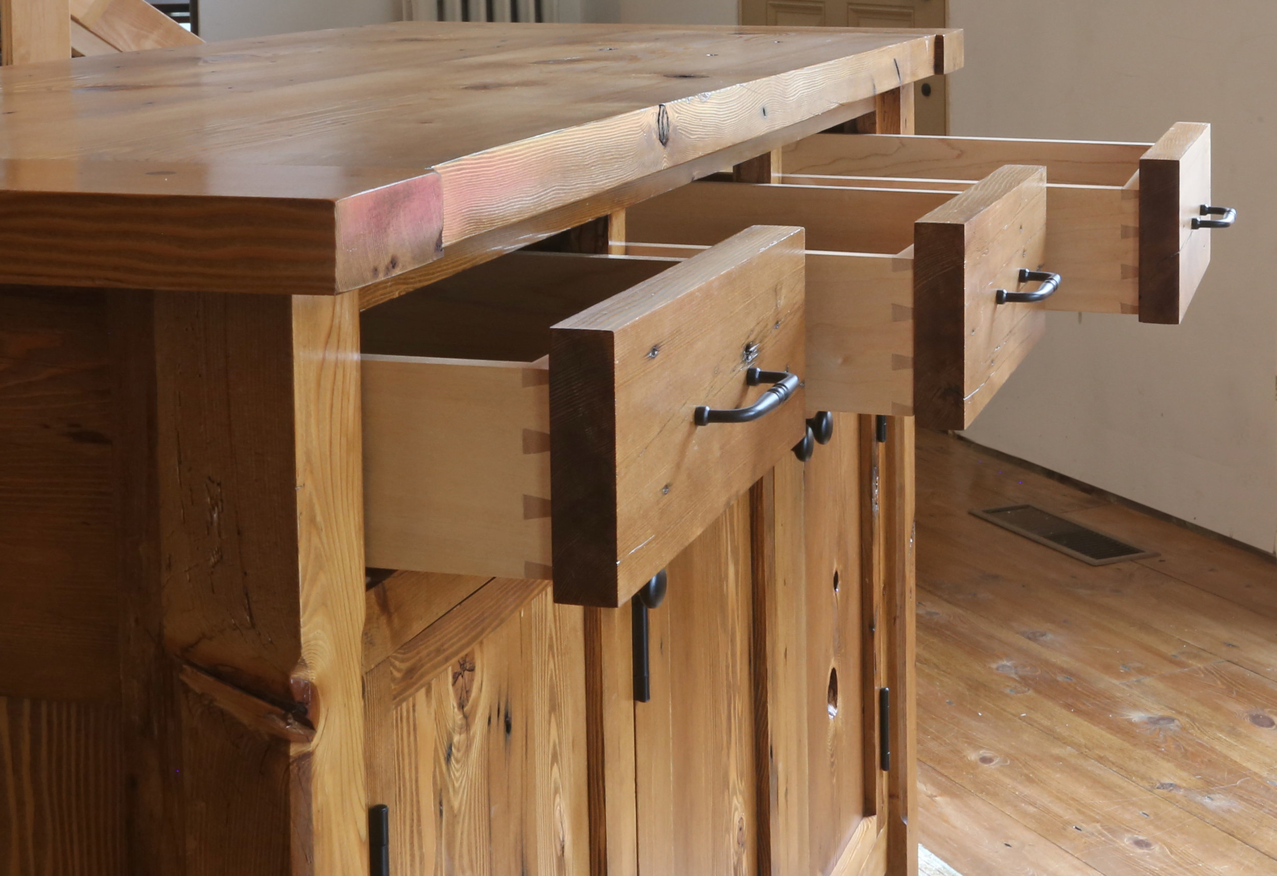 Looking down the dovetailed drawers. I had orignally picked out different drawer pulls, but when they arrived they didn't have the feel I wanted. I opted for larger, heavier pulls that worked better for this piece. Little details can make a big impact on a project like this.