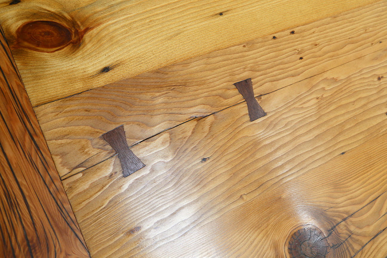 I fabricated and installed these black walnut butterfly keys, also known as Dutchmen, to secure a crack in one of the boards and keep it from growing.
