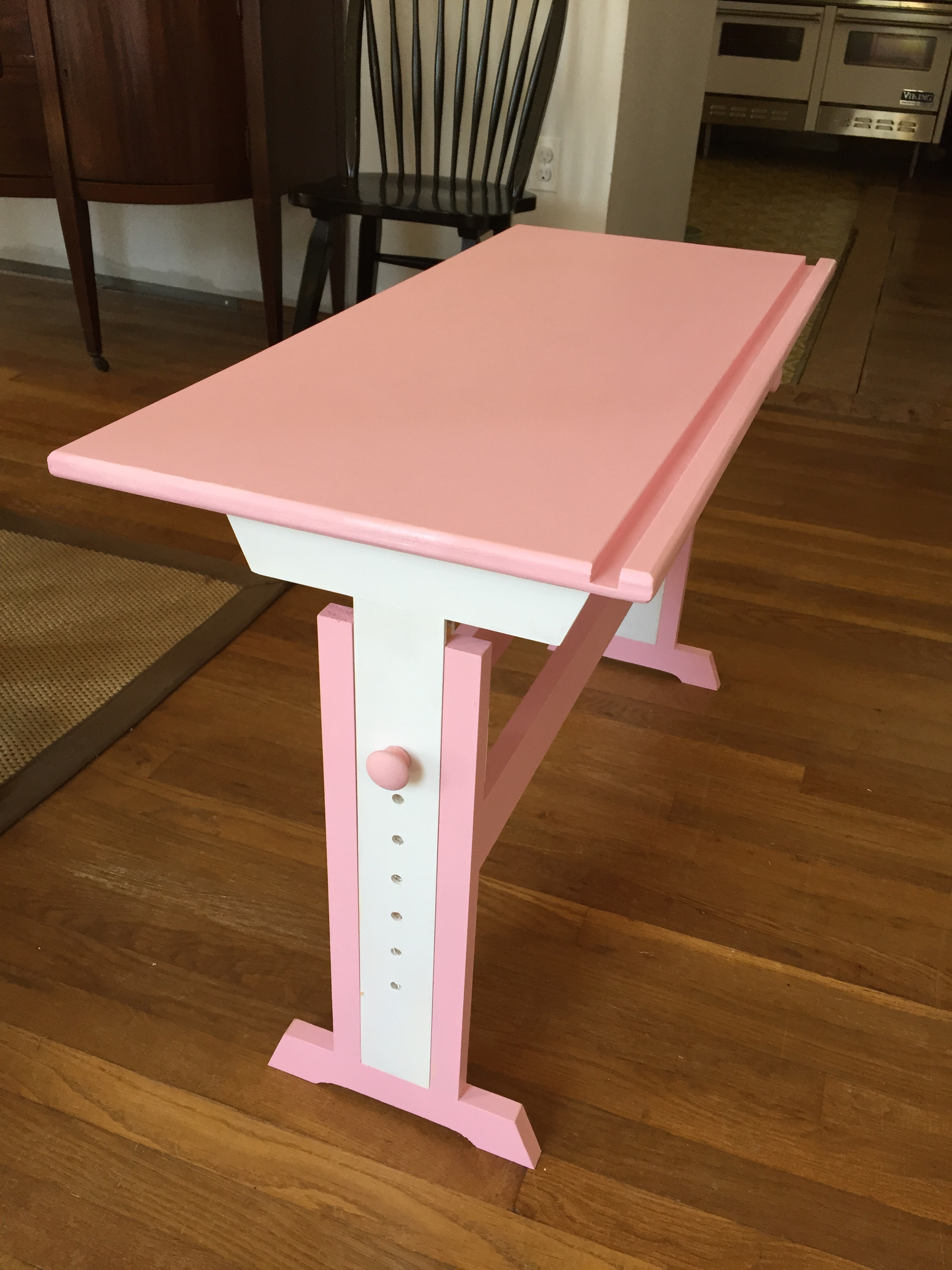 I made a pair of these kid's art desks as gifts for my cousins' kids based on a design I saw online.