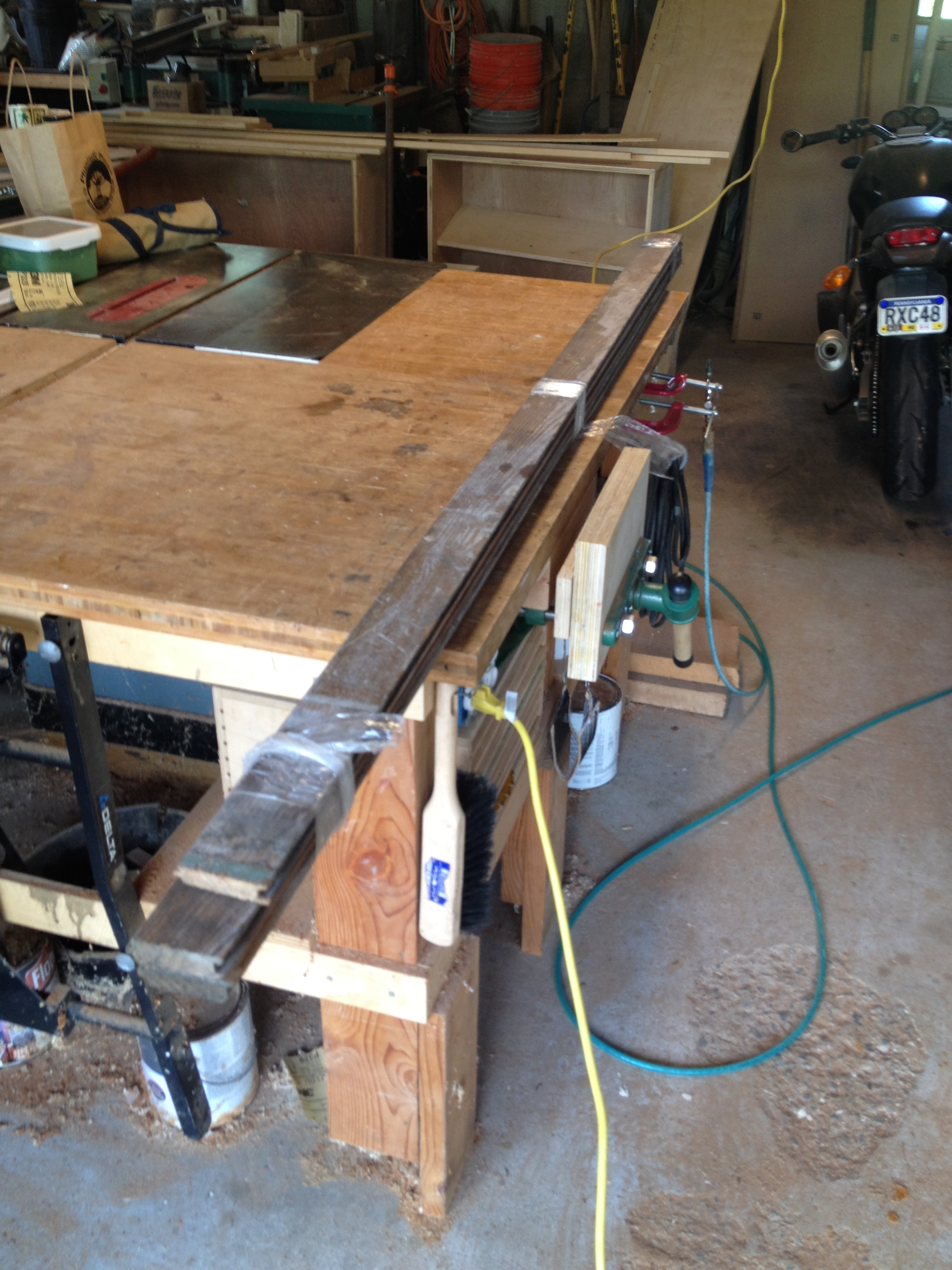 A client asked me to make a table top for an antique treadle base. She wanted to use reclaimed lumber, so we took a trip to the architectural salvage yard and found a bundle of old tongue-and-groove flooring.
