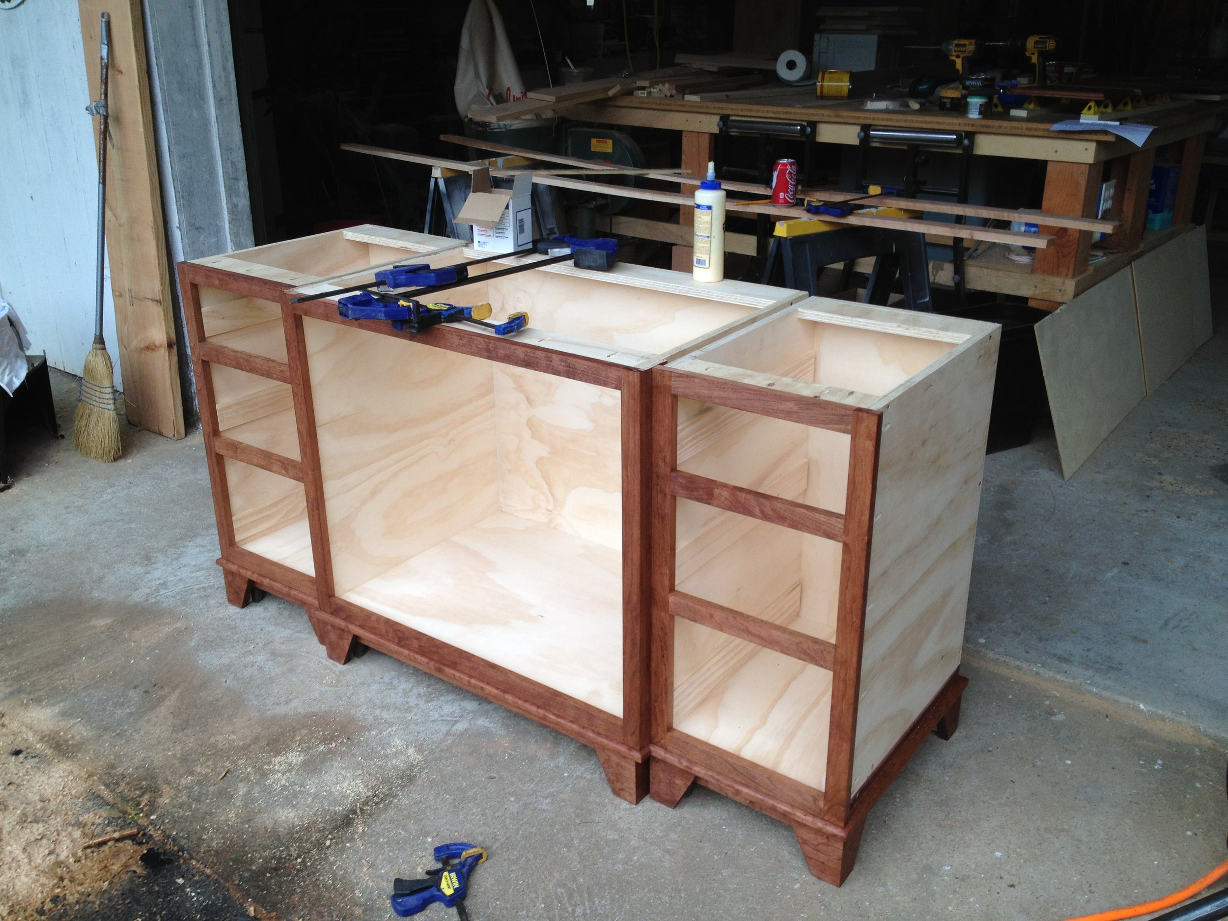 As part of a larger bathroom renovation, I was commissioned to make a custom cherry vanity. Here the base cabinets have been assembled and had the face frames attached. All the cherry face frame and drawer parts were milled down from rough lumber in my shop.