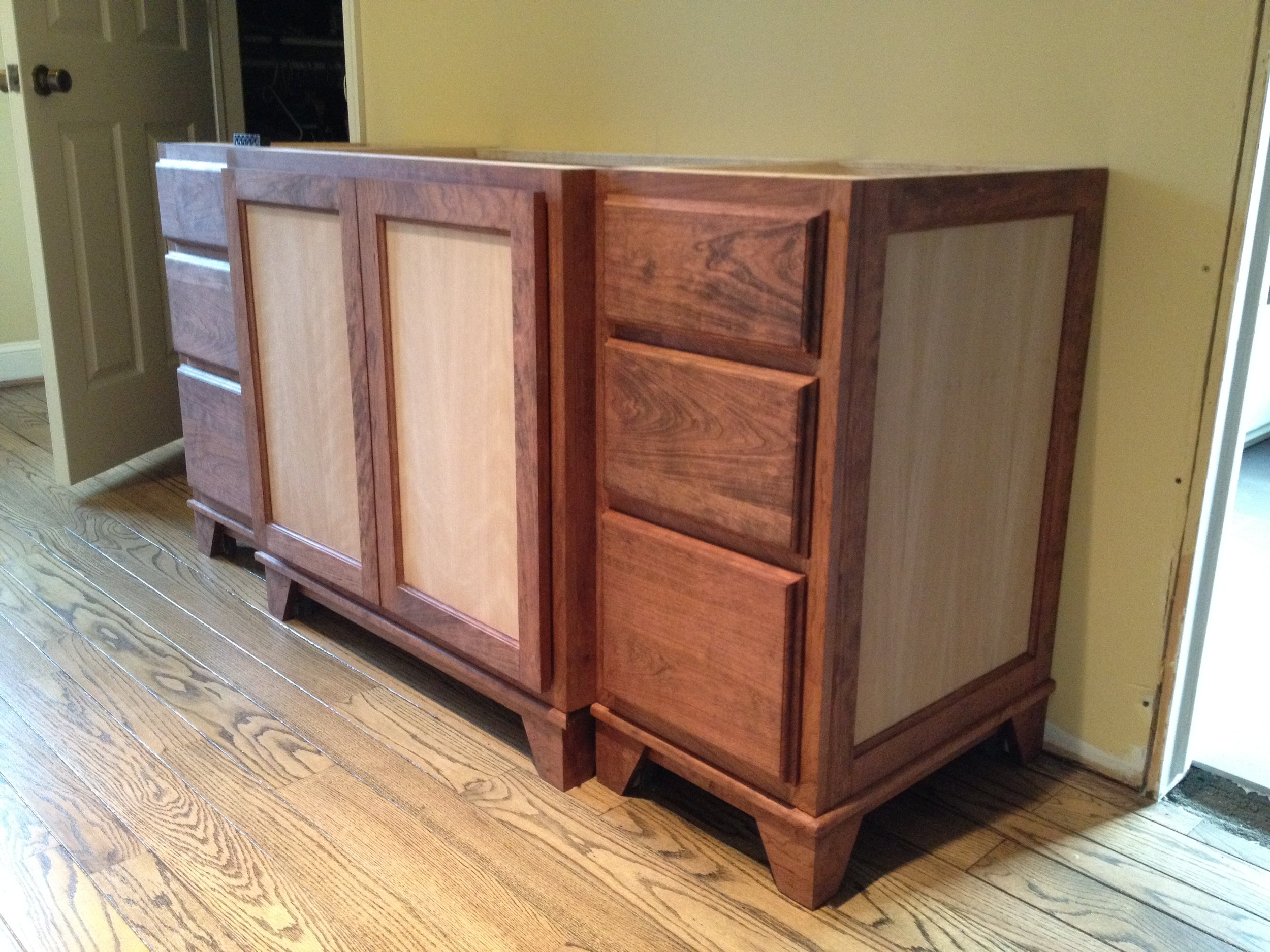 Installed in the client's home. The cabinet doors were built with the same cherry veneer to match the end panels.