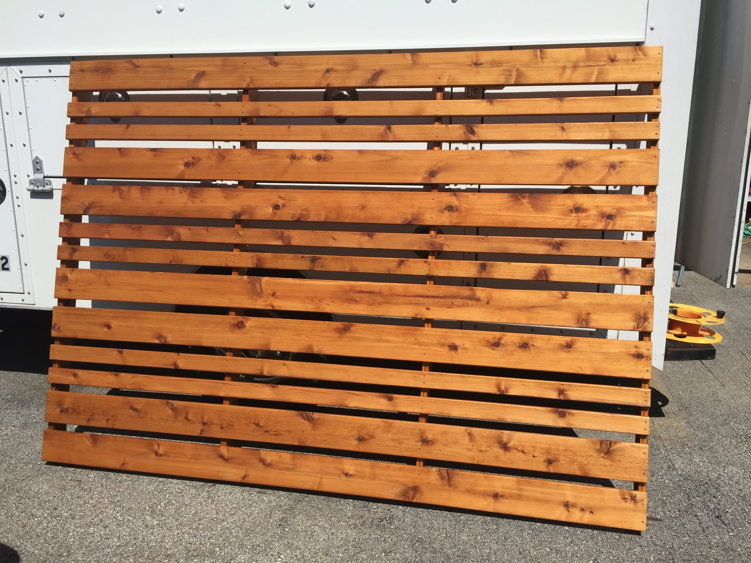 I made up a couple two-sided cedar fence panels using horizontal slats secured to central stiles.