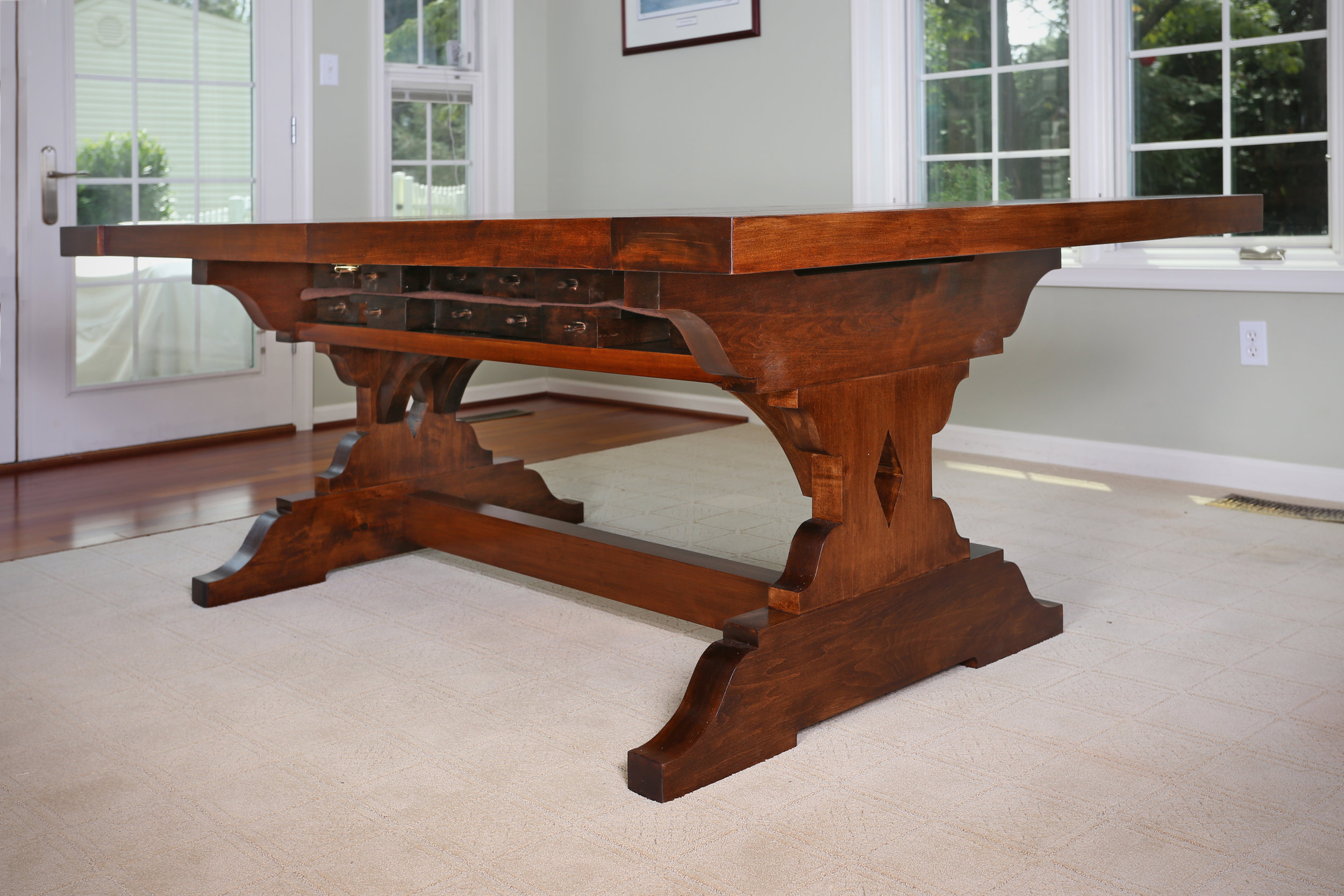 The large stretcher that runs between the bottom sections of the table legs adds additional rigidity to the overall piece.