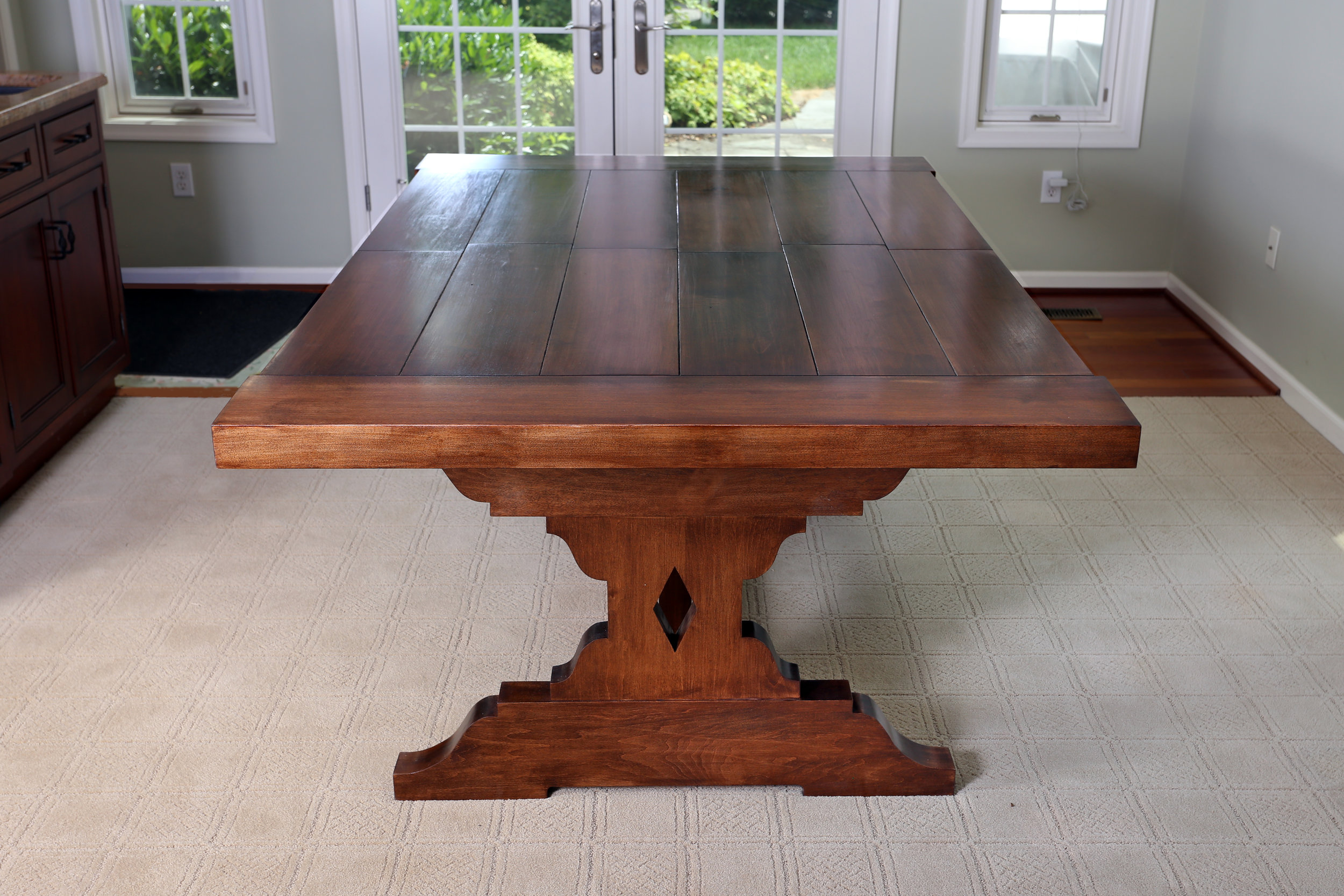 "When the leafs are stored away, the table is 78"" long and can seat 4-6 people comfortably."
