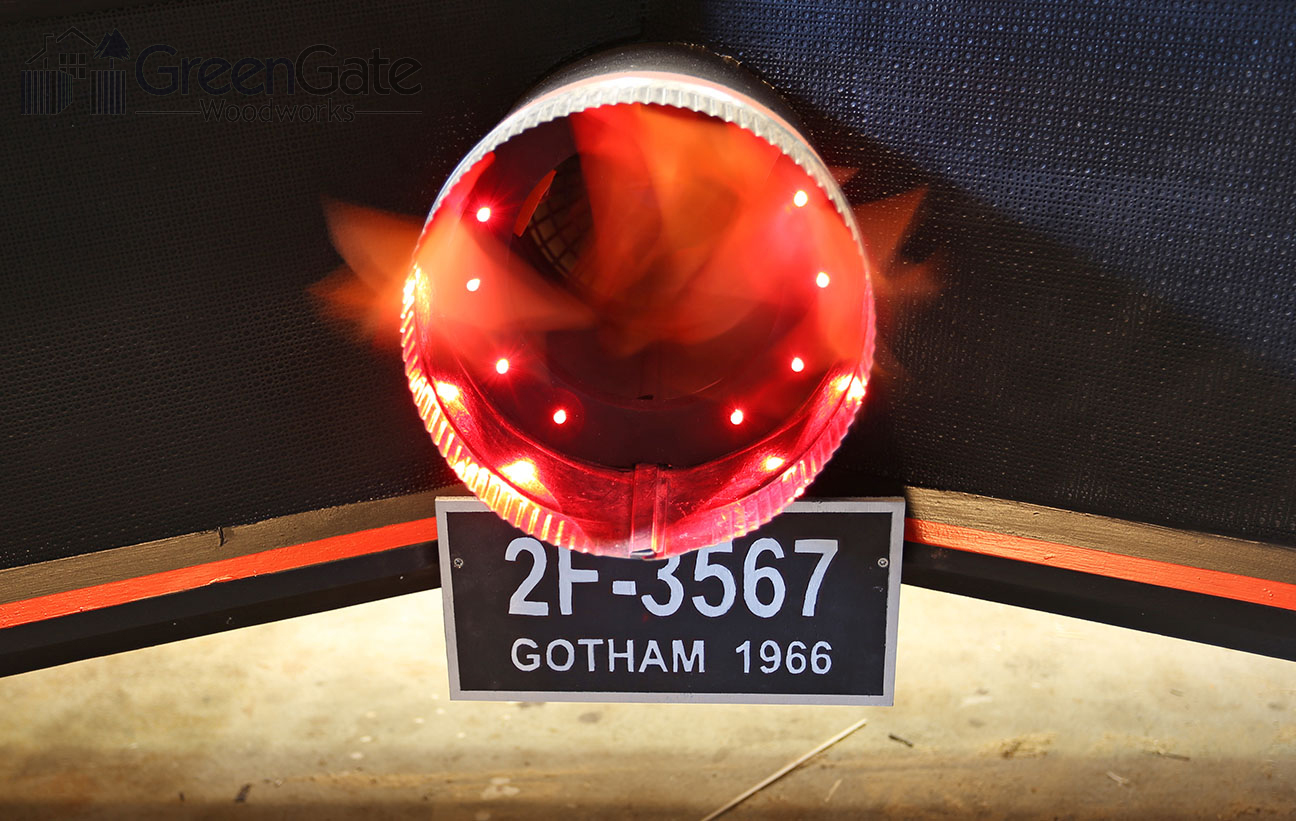 Red LEDs inside the rocket booster give it a warm glow. The license plate is a copy of the one on the original 1960's Batmobile.