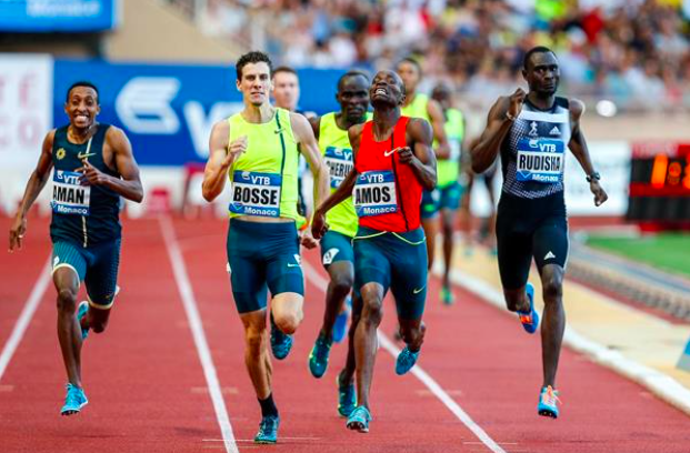 """Figure 3: Big Nije showing off his """"crazy form"""" at the end of a race, leading the legend David Rudisha, 2013 World Champion Mohammed Aman, and French king of cool Pierre-Ambroise Bosse."""