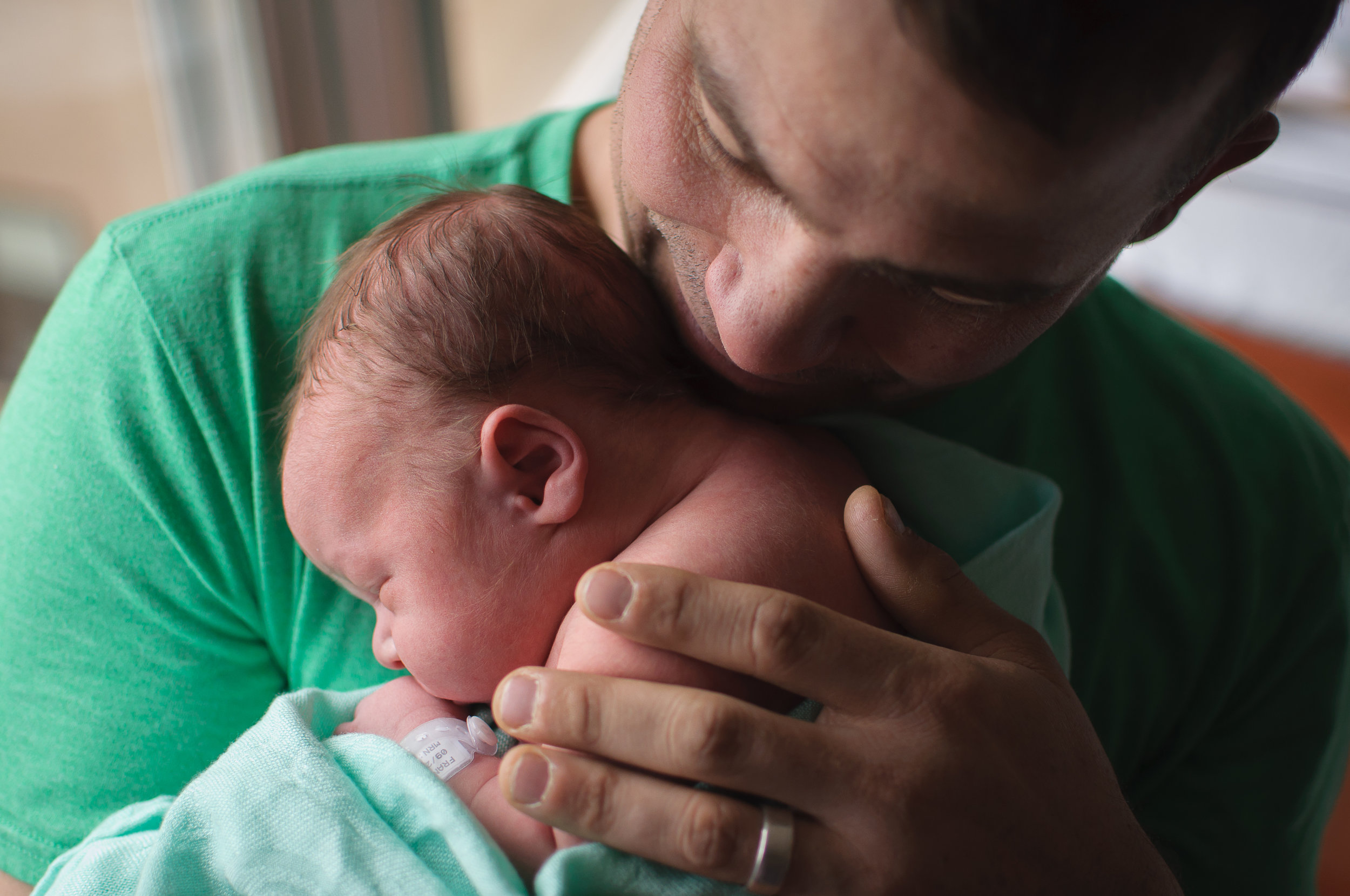 Dad meets newborn baby at fresh 48 session - OSF Saint Francis Peoria IL