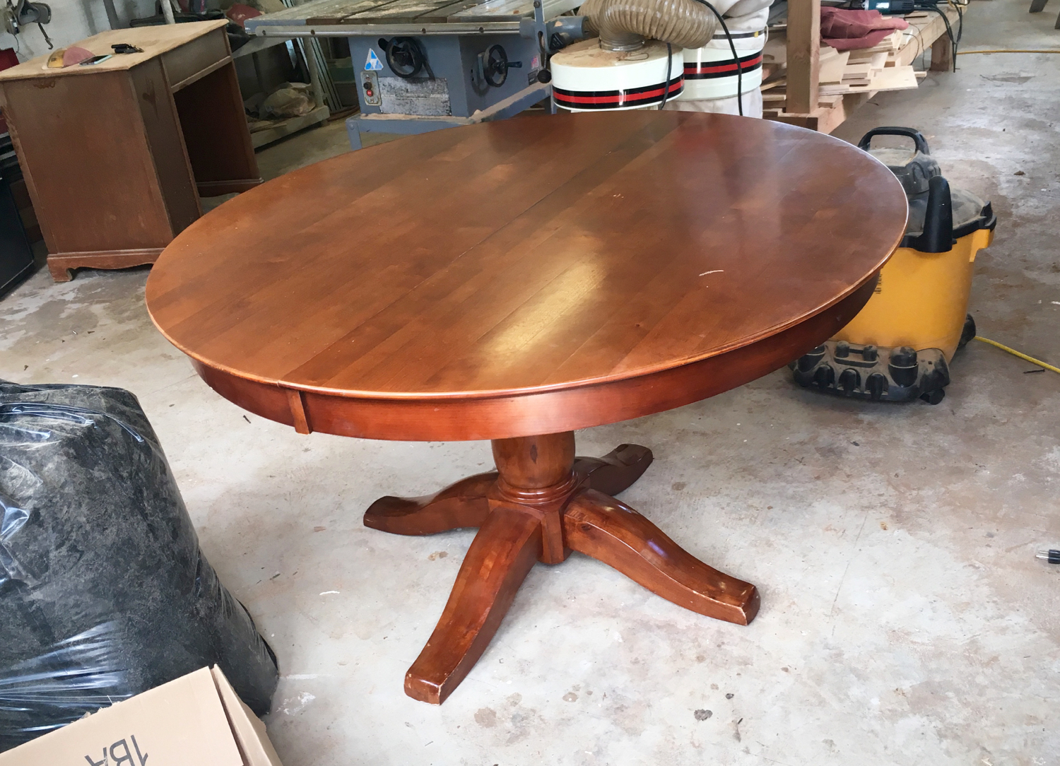 Before picture of the dining table. It's in decent shape, some dings on the top and feet.