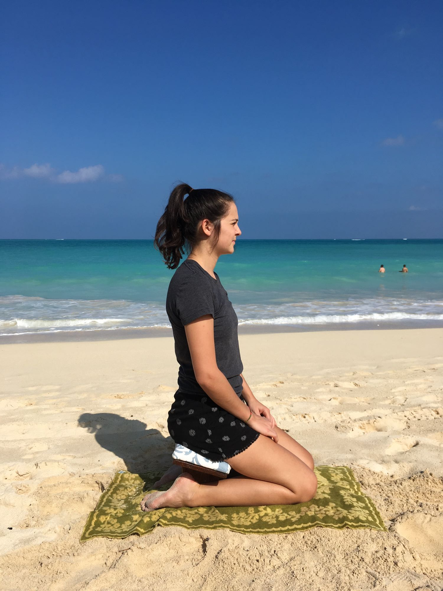 This is how you sit on our meditation benches. Kristina is the model and this picture was taken at the lovely Waimanalo beach.