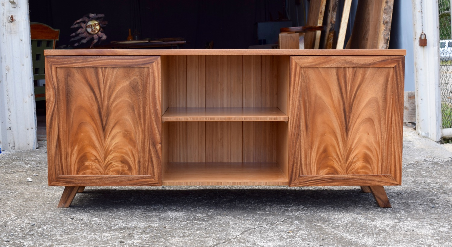 Monkeypod console in front of our showroom