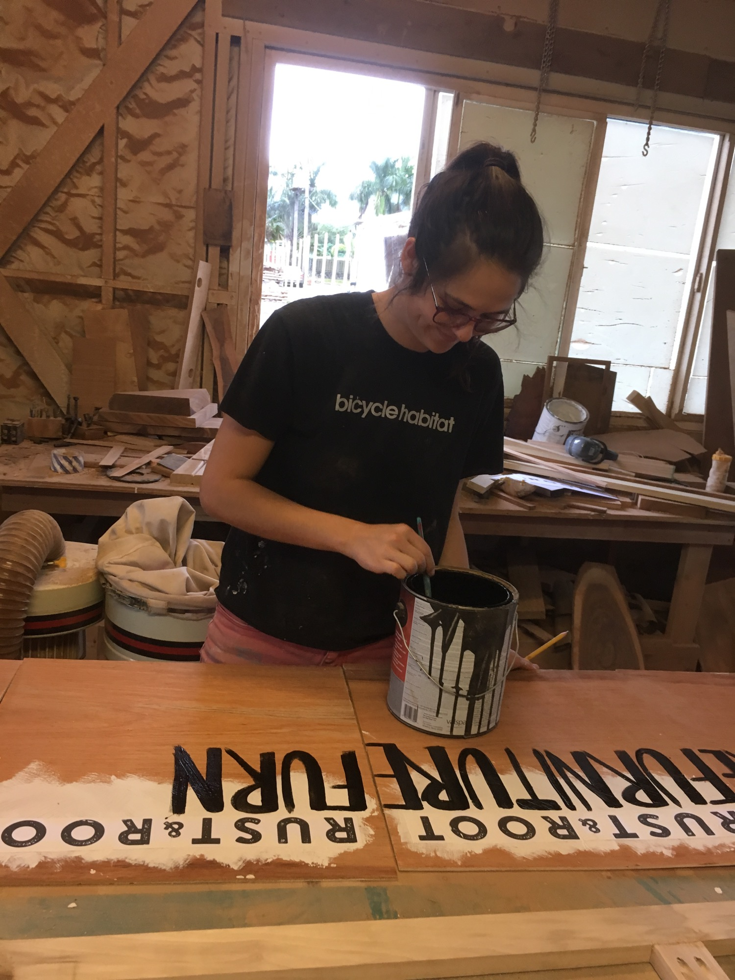 Kristina painting our sale signs